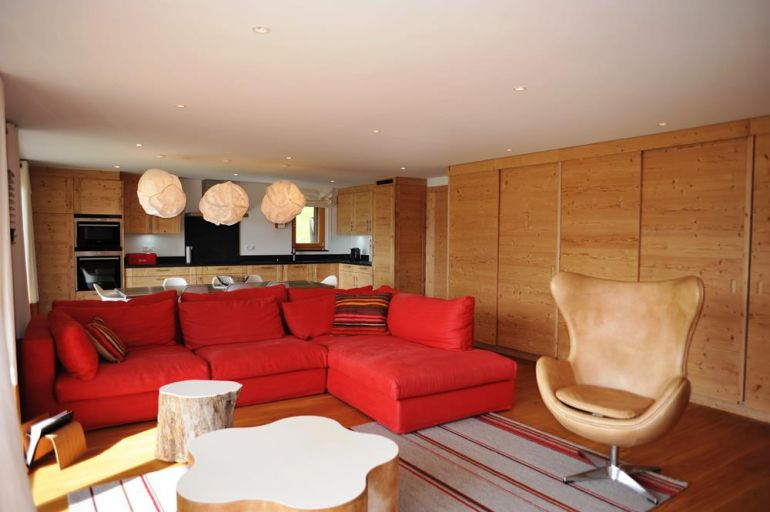 Apartments metairies livingroom with red sofa for sale