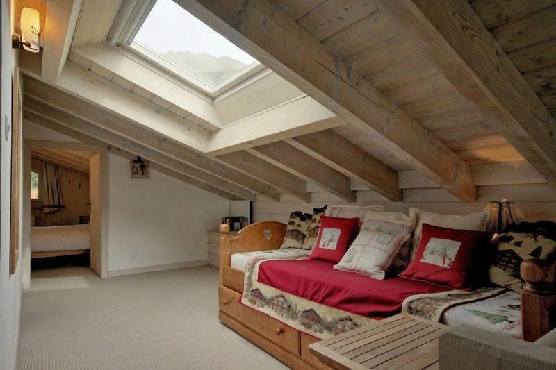 Verbier seating bedroom with look of open ceiling
