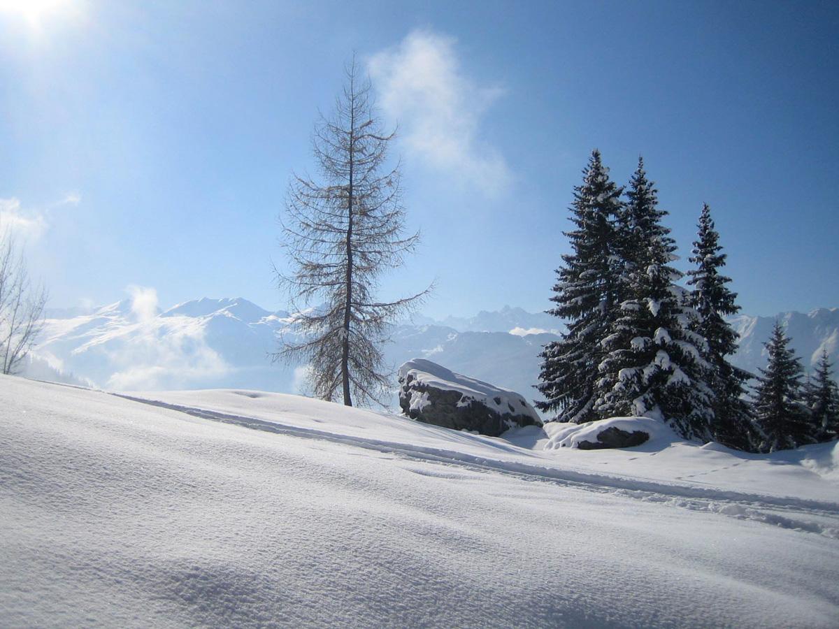 View winter season of verbier with snowfall